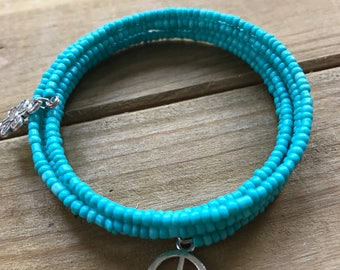 Turquoise Beaded Bracelet with flower and Peace Sign