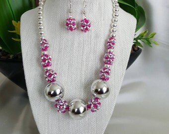 Pink and silver beaded necklace and earrings set