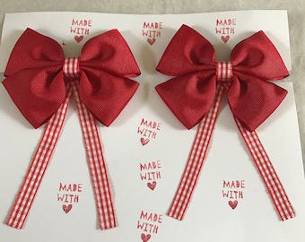 "Red 4"" pinwheel bows with red and white gingham tails"