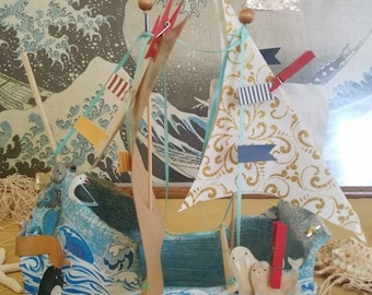 Paper mache ship-B is for baby-