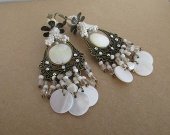 """Camellia"" earrings on a chandelier with mother of Pearl puck beads"
