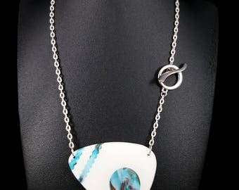 White pendant, turquoise and Brown streaks