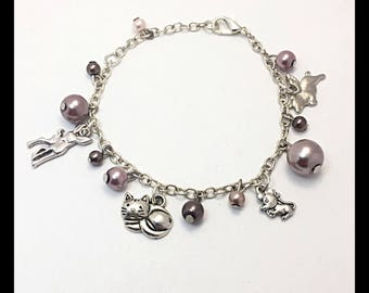 """Animal"" bracelet with glass beads and charms"