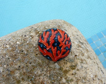 Small coral, hand painted stone.
