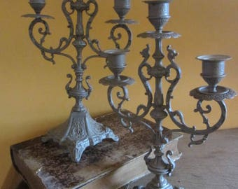 Baroque candle holders metal patina to the old