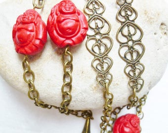 Red Buddha and geometric pendant necklace