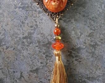 Orange lion metallic with tassel necklace