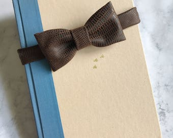Any one bow tie. In Note to Seller say what material/pattern you would like.