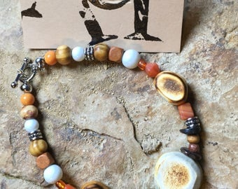 Deer Antler Beads on a Handcrafted Beaded Bracelet with Orange Accents
