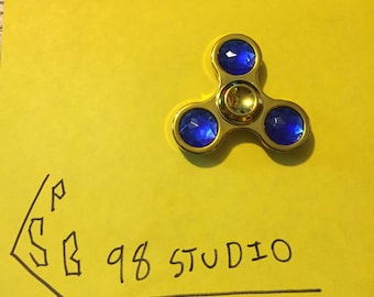 Fidget Spinner with blue glass stones.