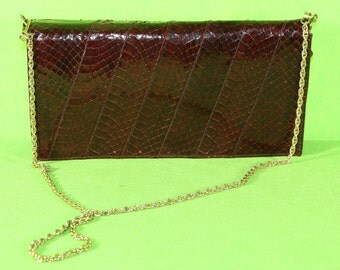 Leather and Python clutch bag with chain strap