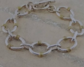 Two-Tone Gold Plated Banded Oval Link Toggle Closure Sterling Silver Bracelet