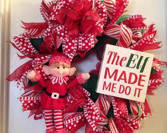 the elf made me do it Red and white deco mesh wreath with Elf