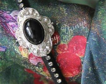 Handmade headband decorated with velvet ribbon and crystal