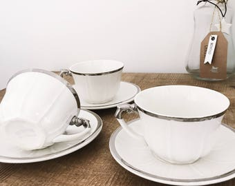 3 cups and saucers porcelain white and silver stamped Valentré monopoly