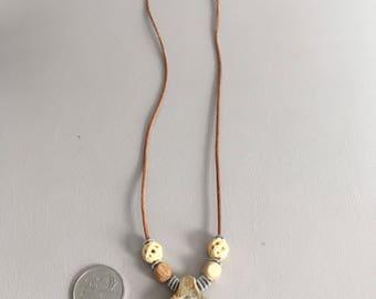 Twin spiral antler pendant