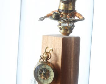 Little Steampunk Minion Robot Sculpture holding a teacup, wearing a crown in glass dome display including a small pocket watch - The King