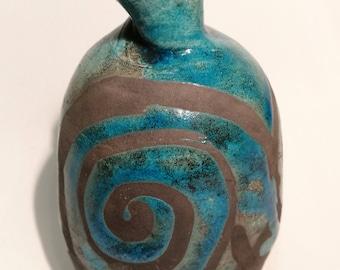 Raku fired turquoise, spiralled small vase