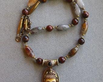 Carved Bone Buddha Pendant Necklace Tibetan Brass Repousse Setting Red Tiger Eye with Labradorite and Rusty Quartz Gemstone Jewelry