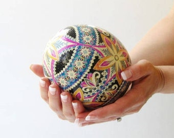 Ostrich egg Pysanka by Katya Trischuk in traditional Ukrainian pattern with pink and blue