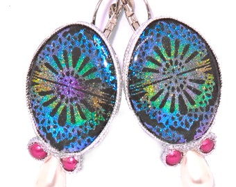 Golden earrings with a sparkling colorful rainbow pattern, sparkling screen print