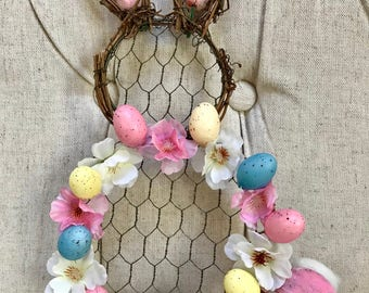 Chicken Wire Easter bunny with eggs and flowers and cotton tail.