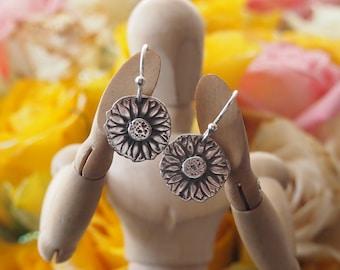 Beautiful daisy flower earrings handmade in fine silver