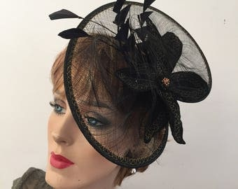 Stunning pie plate fascinator in black for the woman who is constantly the center of attention!