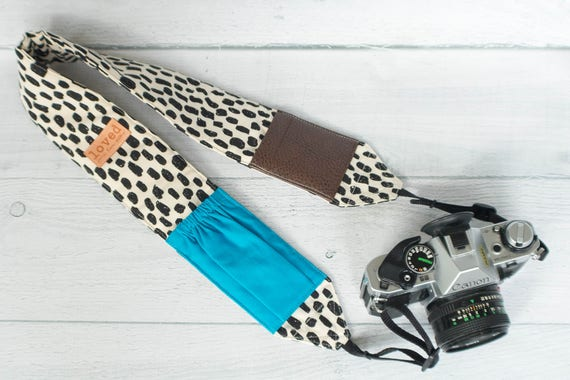 Padded Camera Strap with Pockets | Black and Cream Strap with Leather Lens Cap and Solid Color Pockets