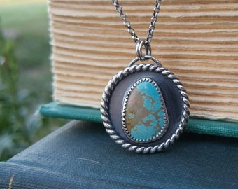 """Number 8 Mine Turquoise and Sterling Silver Necklace. Round Pendant Blue and Tan Turquoise & Twist Wire. On the Reverse 'joy' on 18"""" chain"""