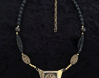 Nataraja. Necklace, vintage glass Shiva intaglio set in polished brass with black/gold beads.