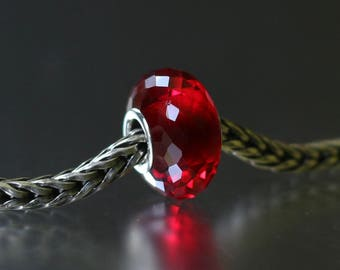 Red faceted glass bead