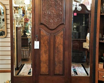 1891 English armoire: burl, carved shells and scrolls, 2 arched beveled mirror panels, cedar-lined. LOCAL PICKUP or buyer hires freight.