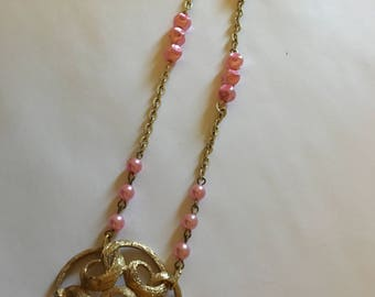 gold  charm with pink necklace