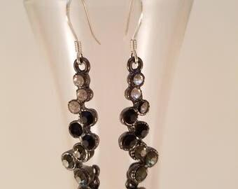 Black and white dangle earrings.