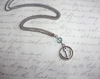 Anchor charm necklace with blue crystal