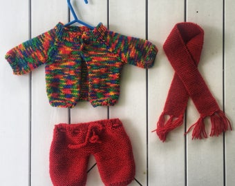 Hand knitted clothes for teddy bear or doll