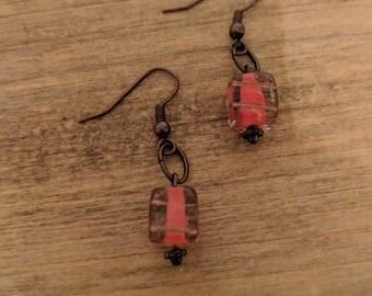 Orange and clear glass dangle earrings