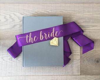 The bride sash, bachelorette sash, purple and gold sash, bachelorette sash with gold diamond pin, hen sash, hen party sash, bridal sash