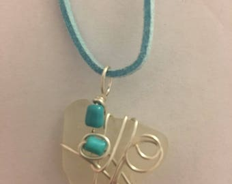 White sea glass necklace wrapped in silver wire with turquoise color beads