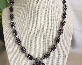 Purple and silver pendant necklace made with beaded beads