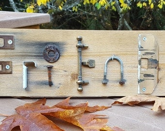FRIENDS Sign on Cedar Plank - made with re-purposed hardware.
