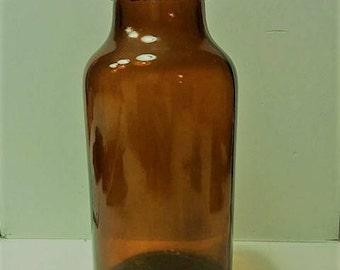 Old amber glass bottle