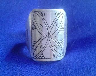 Silver ring carving. Beautiful patterns.
