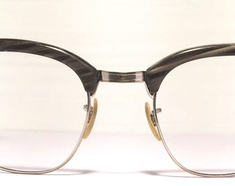 Vintage eyewear. Made in USA by Shuron. 1950's. Gray wood grain color on gold filled eye wire and bridge. Classic Midcentury modern style.