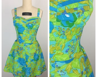 Vintage 1950s Playsuit / 60s Hawaiian Green and Turquoise Floral Skirted Beach Romper / Medium