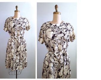 Flirty Floral   1960s brown and white floral dress   60s drop waisted dress