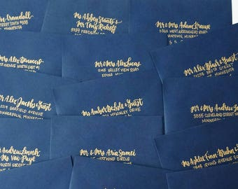 gold calligraphy for wedding invitations and party invitations // gold and silver handwritten addresses for mailing envelopes