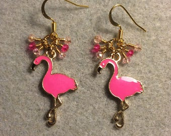 Hot pink enamel flamingo charm earrings adorned with tiny dangling hot pink and light pink Chinese crystal beads.