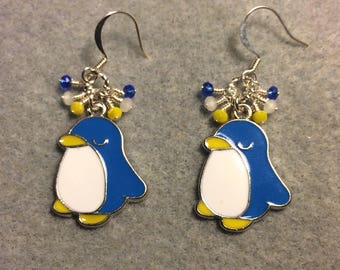 Blue, white, and yellow enamel penguin charm earrings adorned with tiny dangling blue, white, and yellow Chinese crystal beads.